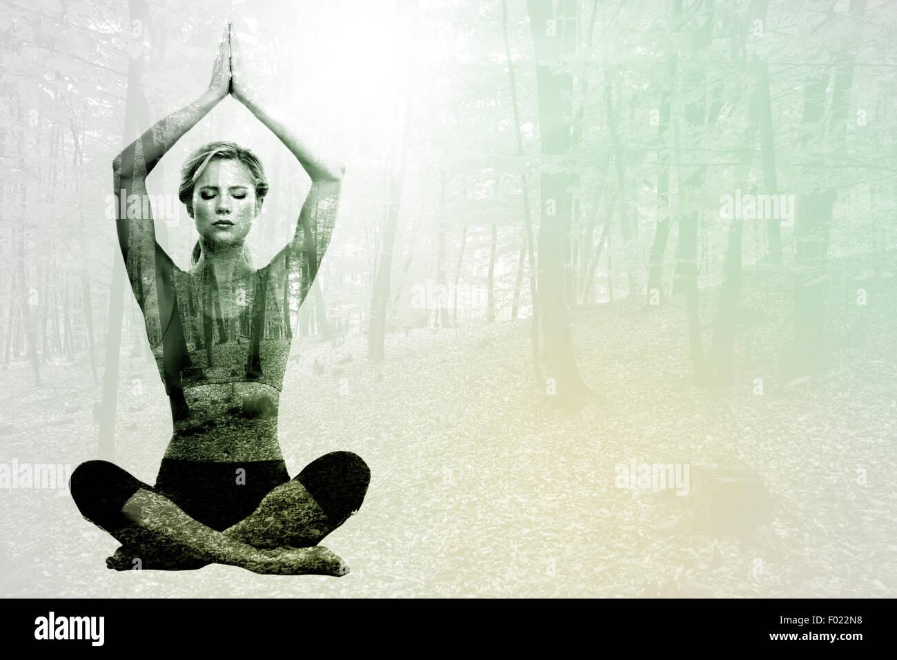 Zusammengesetztes Bild ruhig blonde meditieren in Lotus-Pose mit erhobenen Armen Stockbild