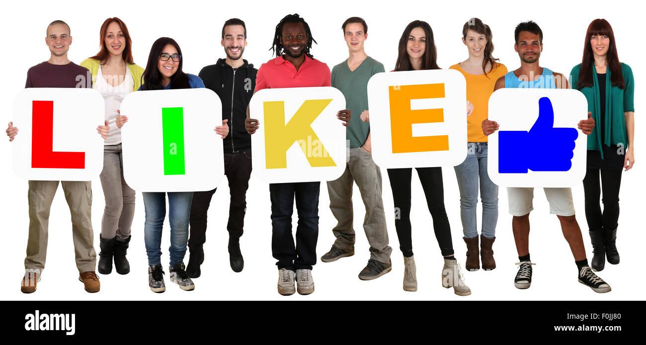 Gruppe von jungen Multi lächelnd wie ethnische Leute halten Wort isoliert auf weiss Stockbild