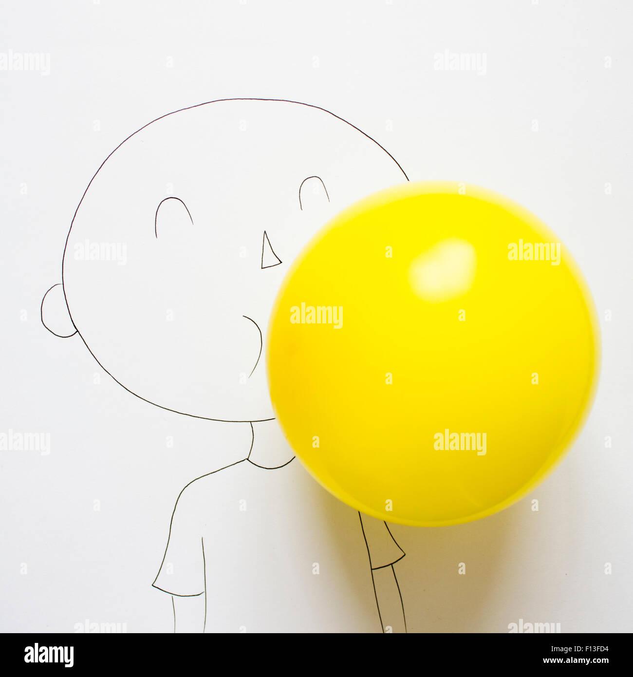 Konzeptionelle Zeichnung eines jungen bläst einen Ballon Stockbild