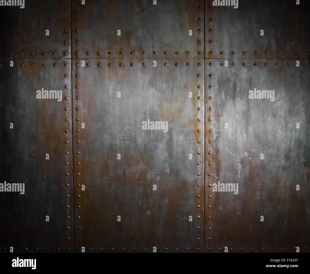 fadenscheinig rostigem Stahl mit Nieten, Eisen-Hintergrund Stockbild