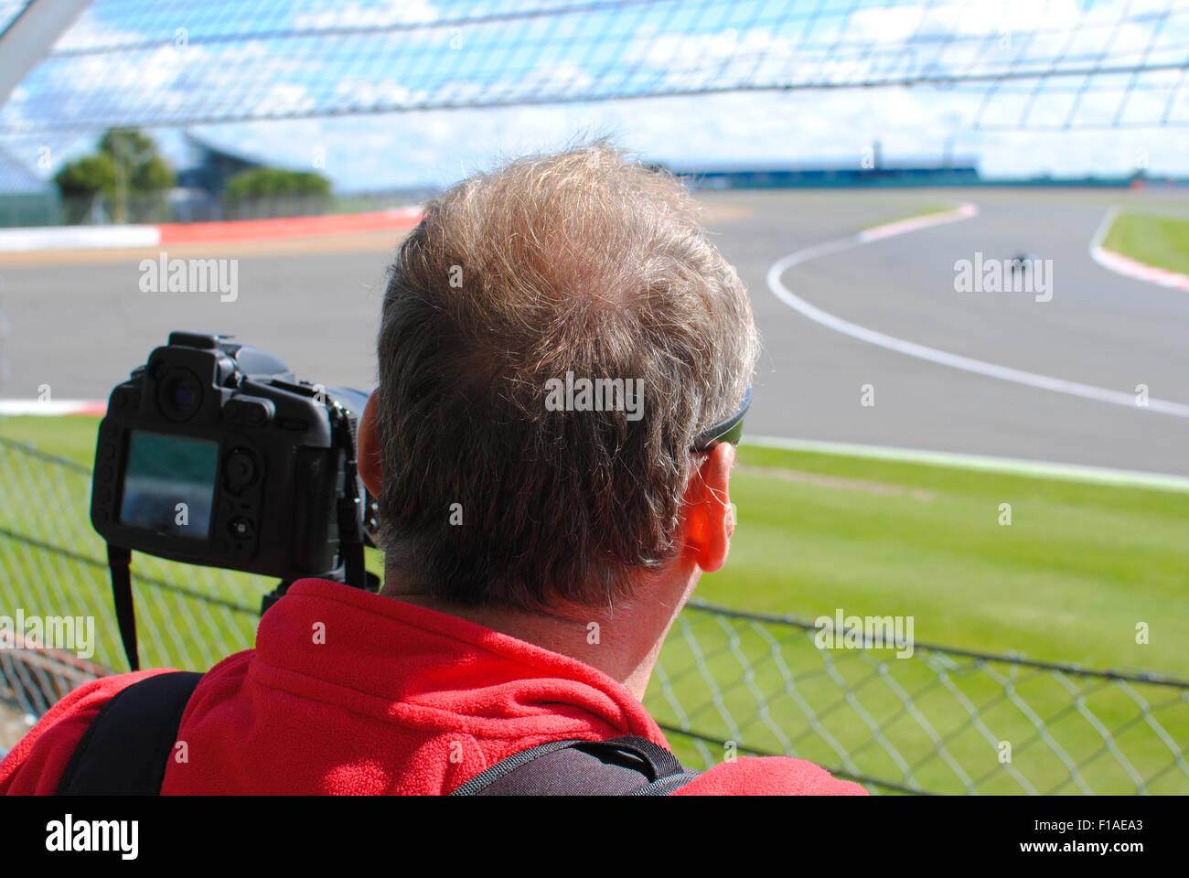 Motorsport-Fotograf Stockbild