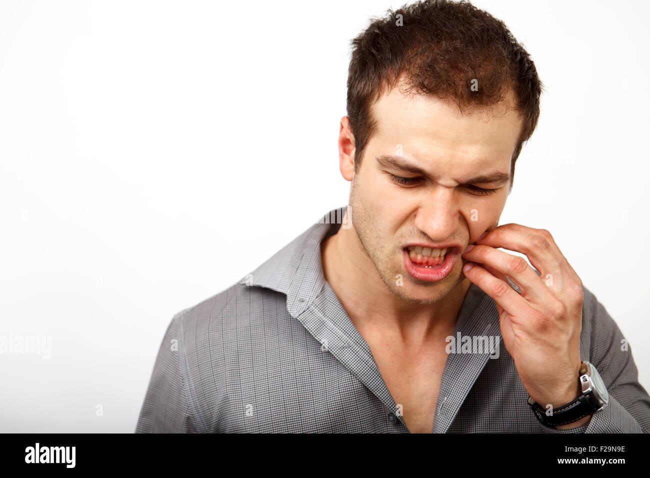 Zähne-Schmerz-Konzept - Mann leidet unter Zahnproblemen Stockbild