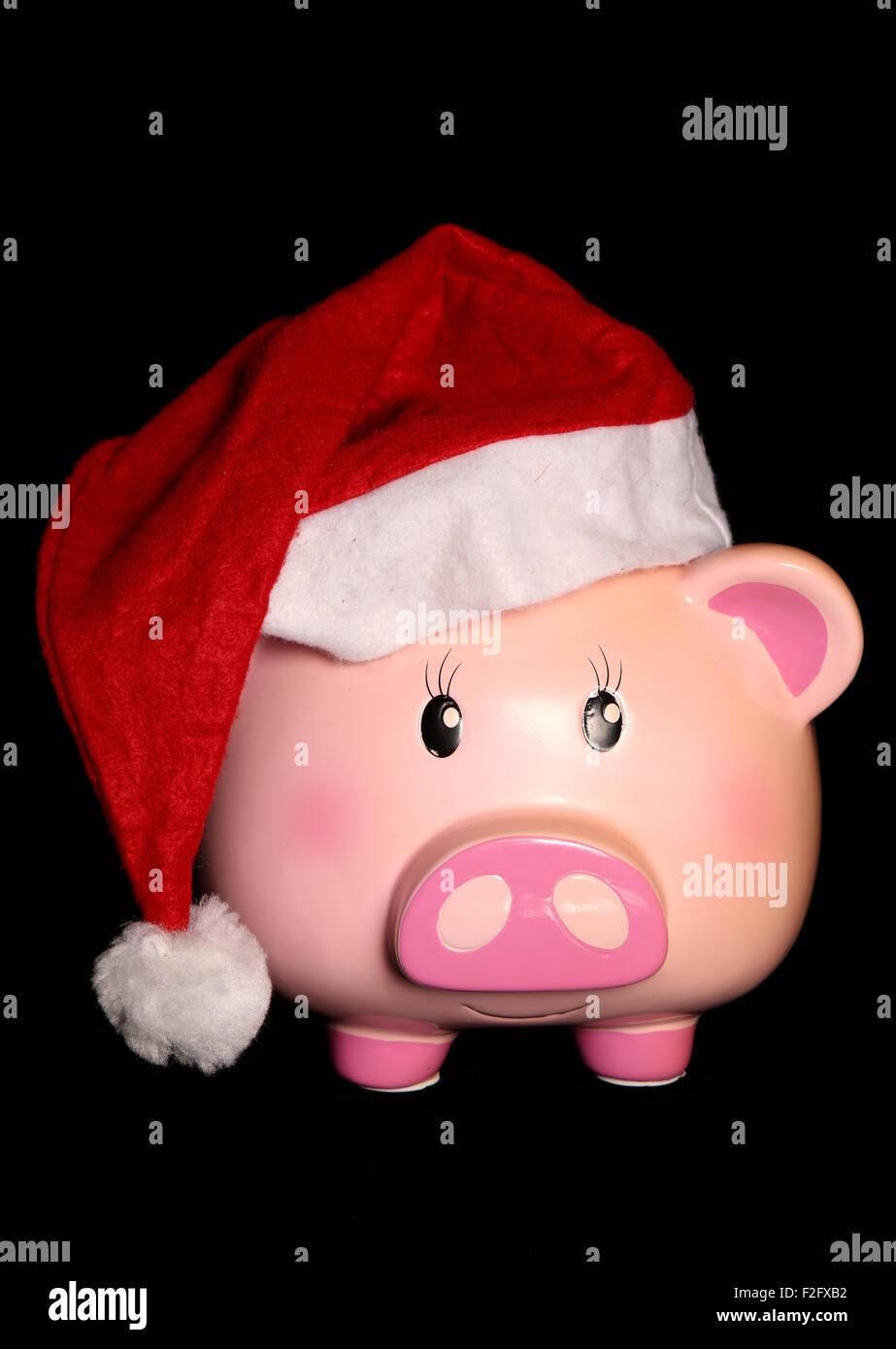 Piggy Bank tragen ein Santa Hut Schnittmuster Stockfoto, Bild ...