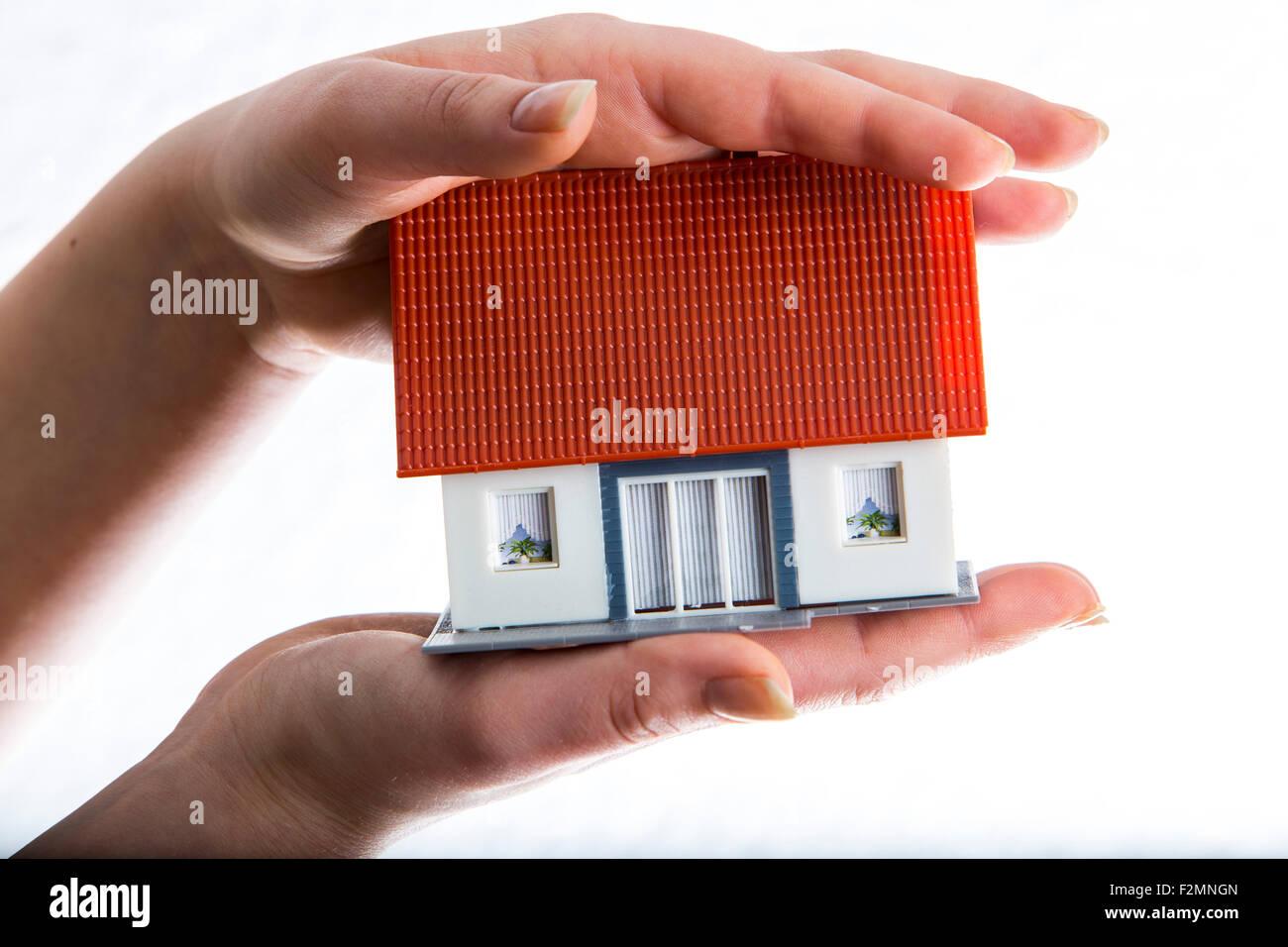 Symbolisches Bild, privates Haus, Immobilien, Schutz, sicher, Sicherheit Stockbild
