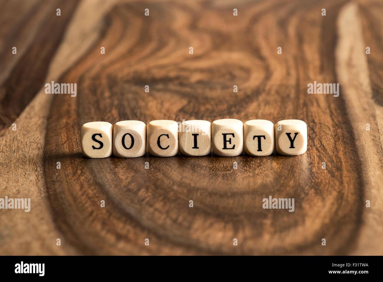 Gesellschaft-Word-Hintergrund auf Holzblöcke Stockbild