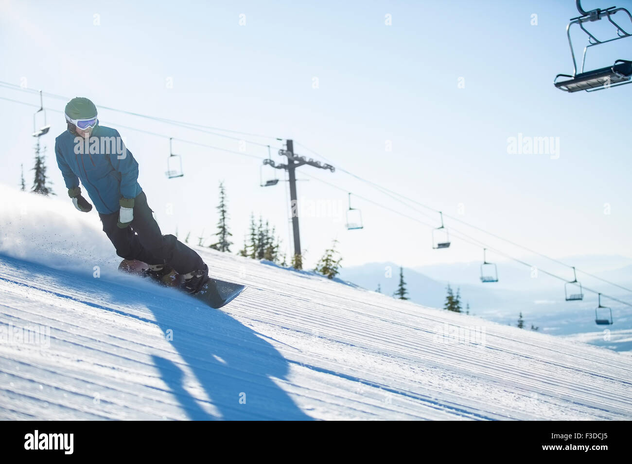 Downhill Snowboard Mann Stockbild