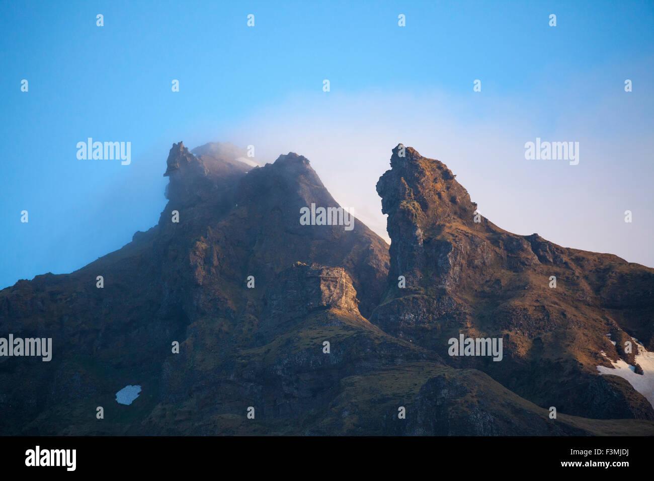 Berg pinnacles aus vulkanischem Gestein über Grundarfjordur, Halbinsel Snaefellsnes, Vesturland, Island. Stockbild