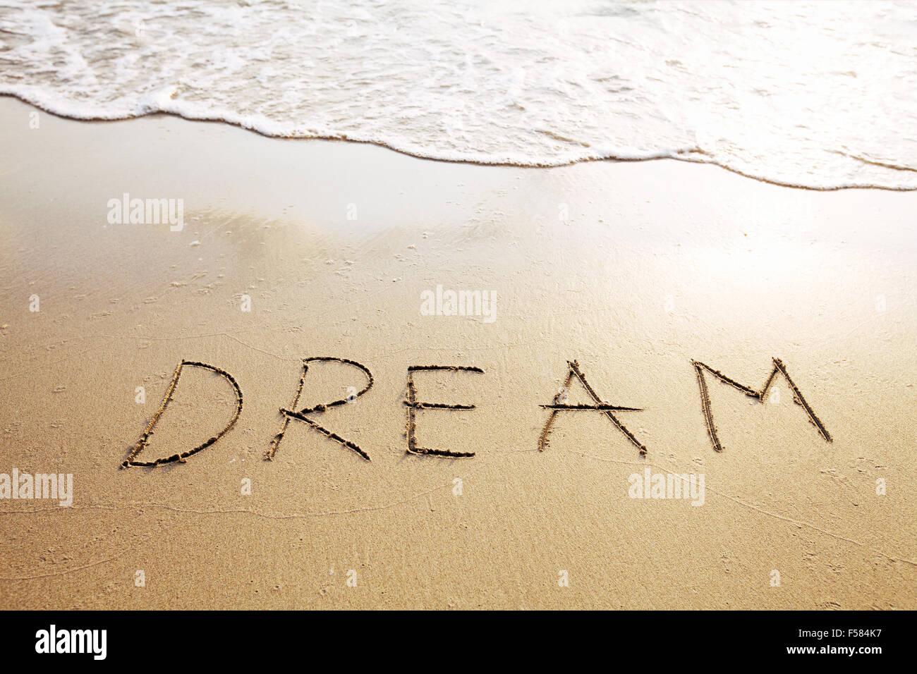 Traum - Wort geschrieben am Strand Stockbild