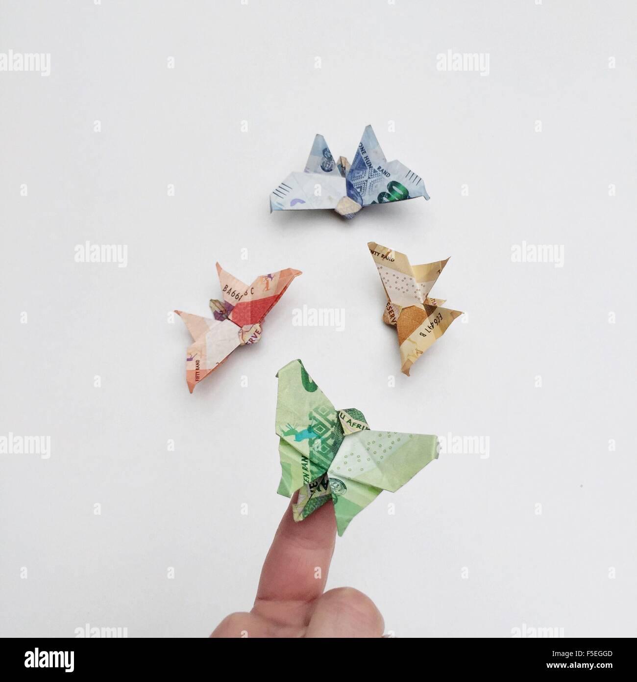 Origami Schmetterlinge gemacht von Papiergeld Stockbild