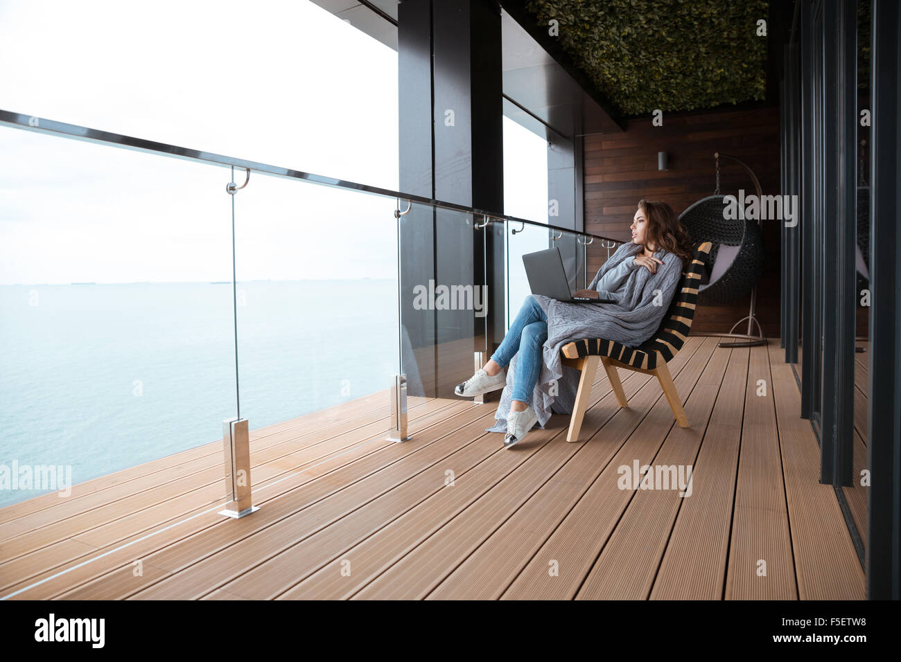 woman sitting in chair knitting stockfotos woman sitting. Black Bedroom Furniture Sets. Home Design Ideas