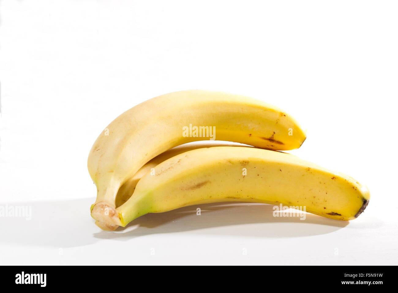 Die Bananen von den Kanarischen Inseln auf weißem Hintergrund, cavendish Vielfalt Stockbild