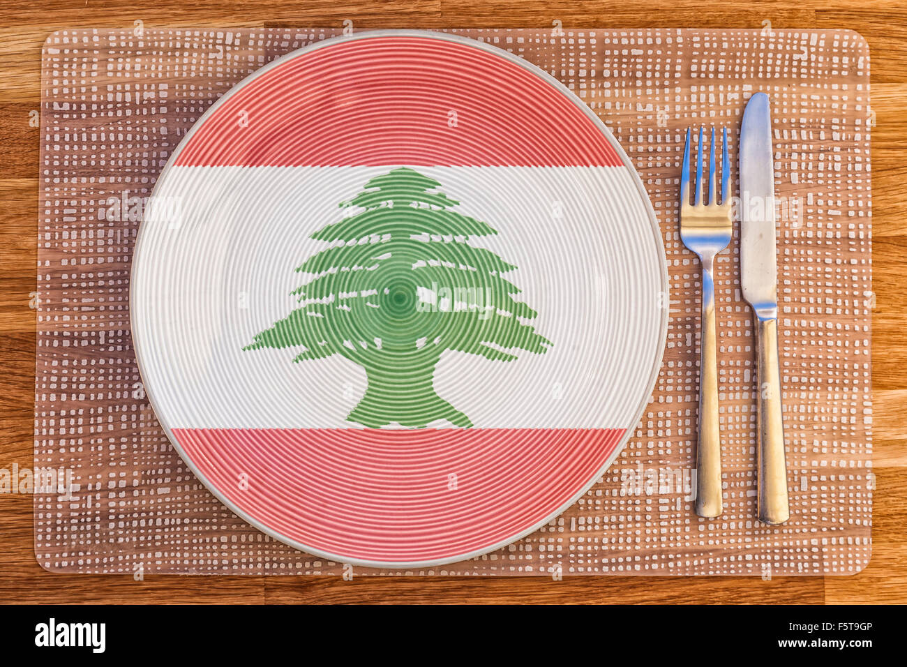 Teller mit der Flagge des Libanon darauf für Ihre internationale ...