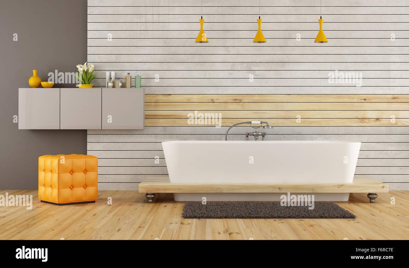Moderne Badezimmer mit Badewanne vorne am Beton und Holz ...