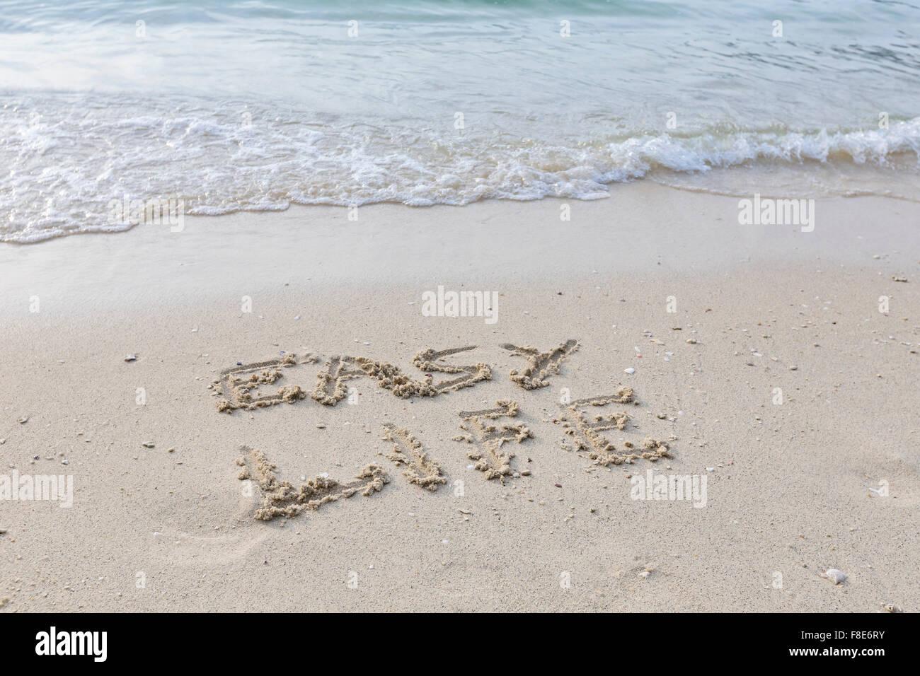 Einfaches Leben in feuchten Sand ausgeschrieben Stockbild