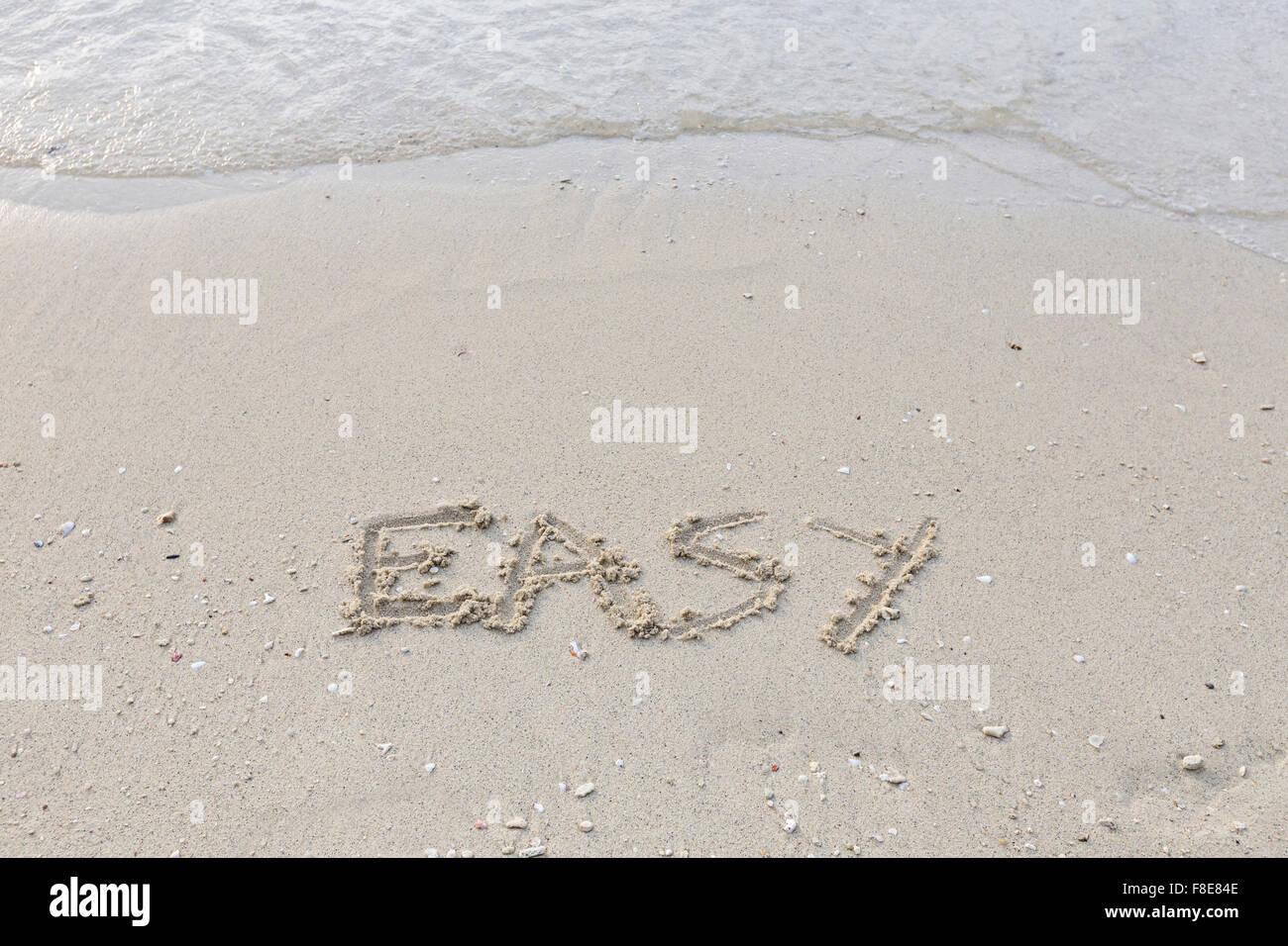 Einfach im nassen Sand ausgeschrieben Stockbild