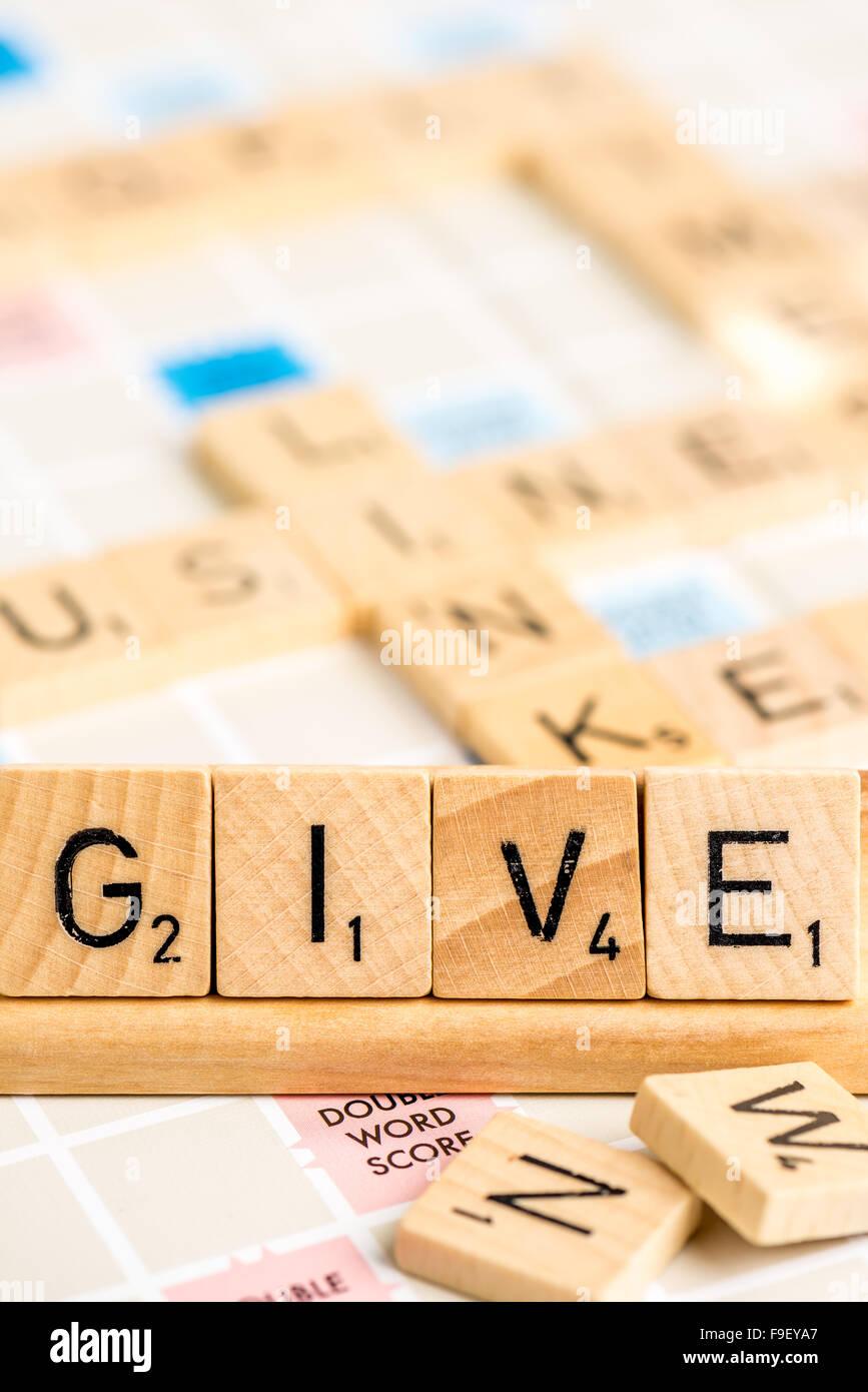 Scrabble - geben Stockbild
