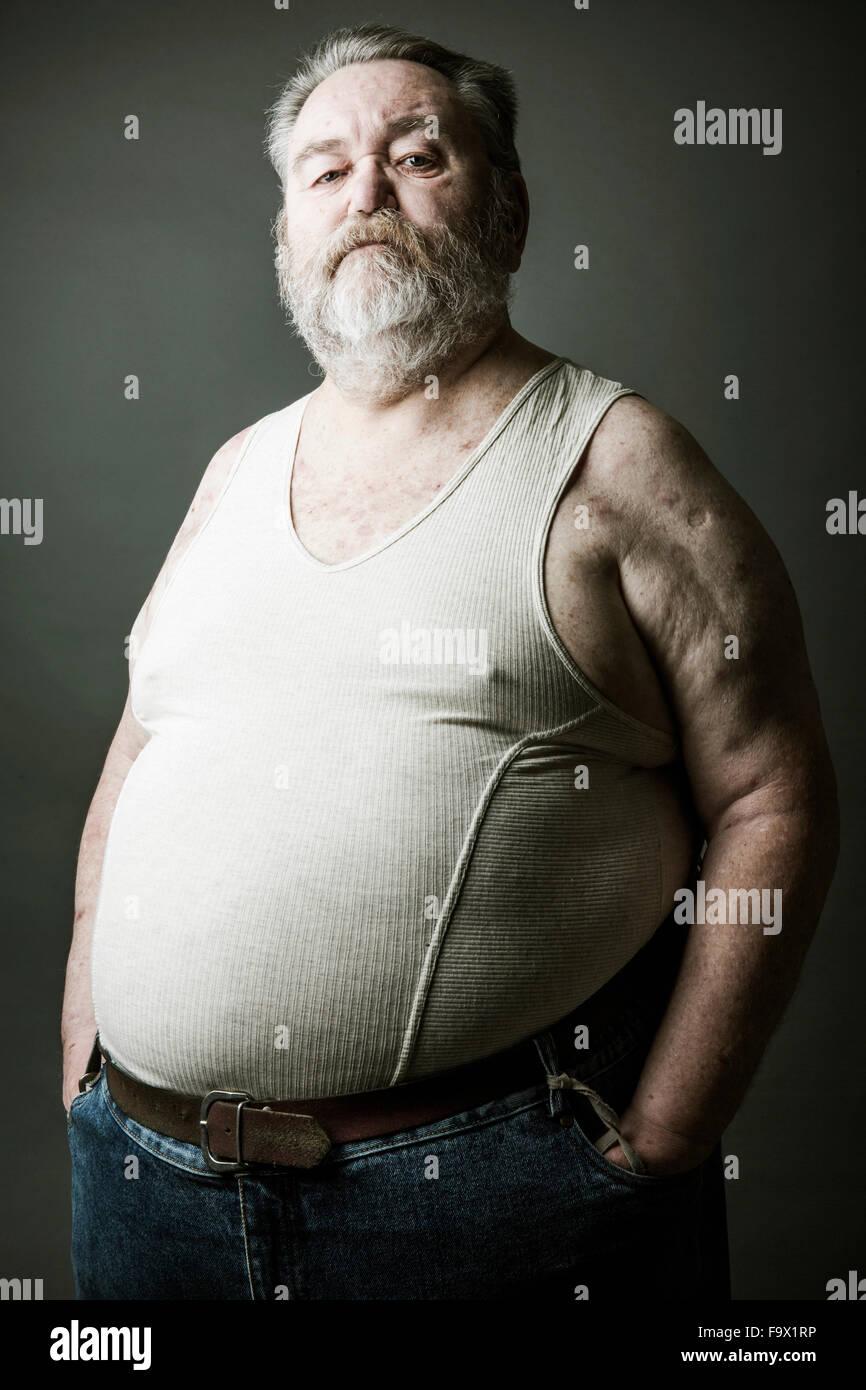 Porträt der ältere Mann mit Vollbart mit Weste Stockbild