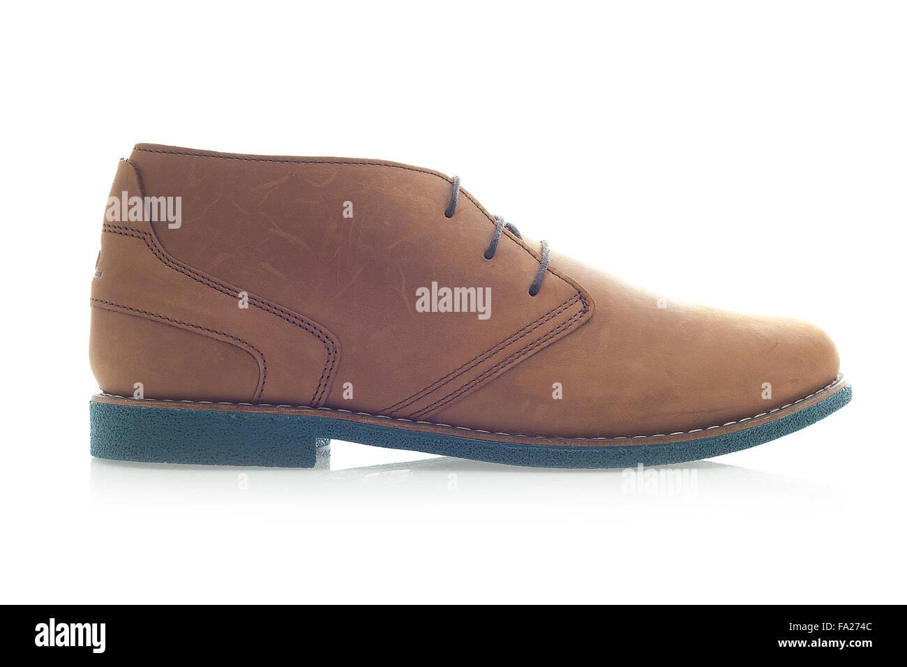 Mens Brown Suede Schuh auf weißem Hintergrund Stockbild