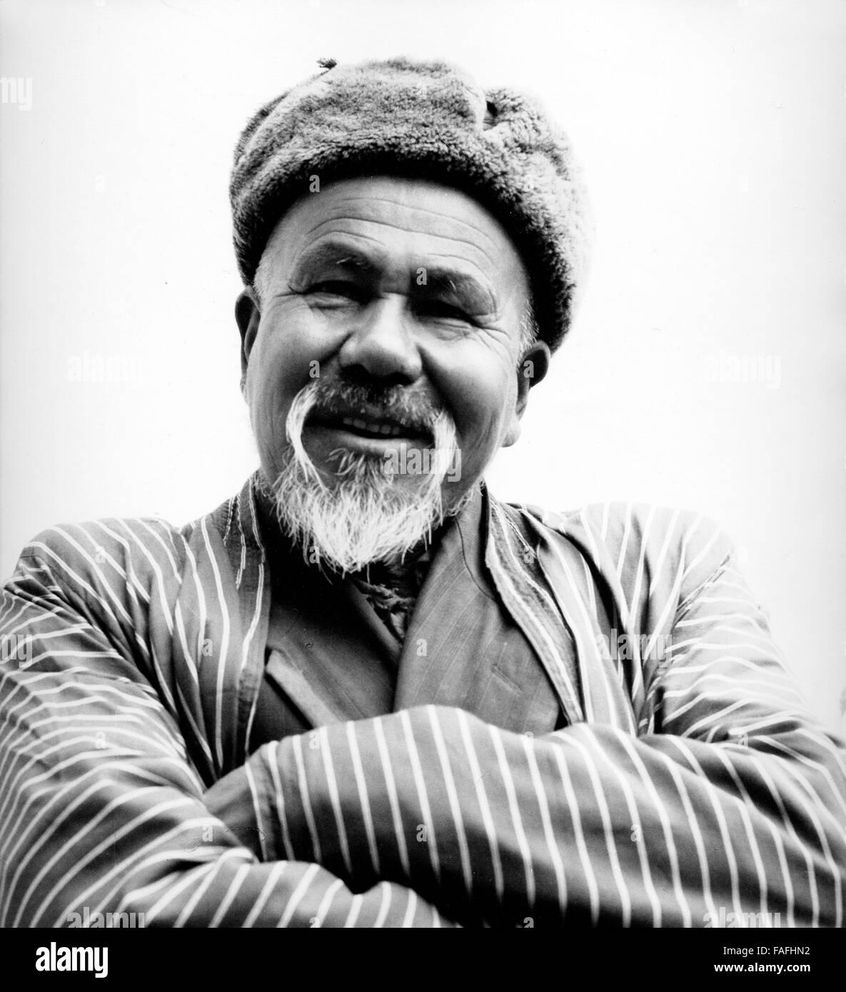 Ein Mann in Buchara in Usbekistan, Bezirkshandstempel, 1970er Jahre. Ein Mann von Buchara, Usbekistan, Sowjetunion, Stockbild