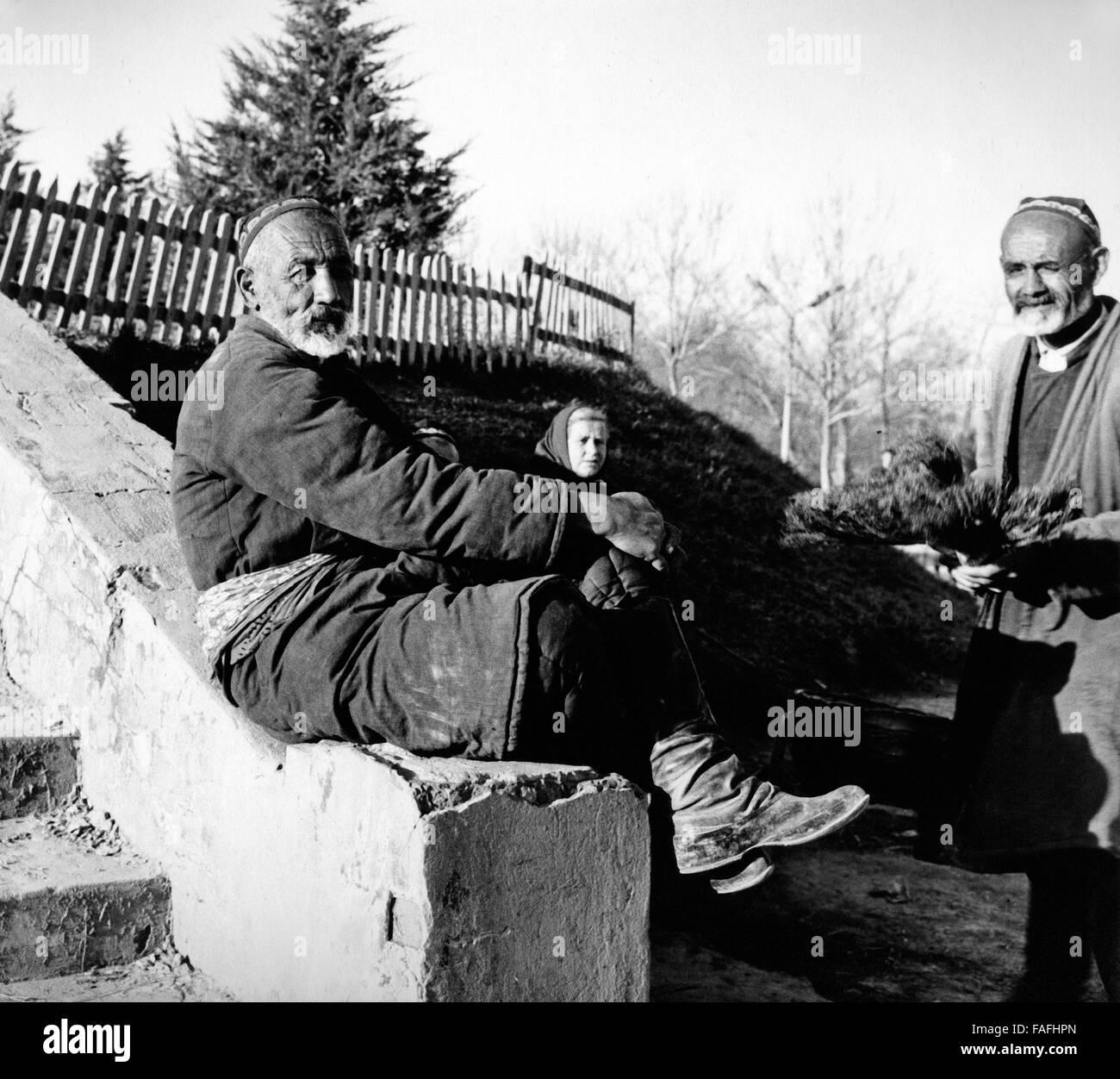 Ein Besenverkäufer eine seit Stand Auf Dem Basar in Taschkent in Usbekistan, Bezirkshandstempel 1970er Jahre. Stockbild
