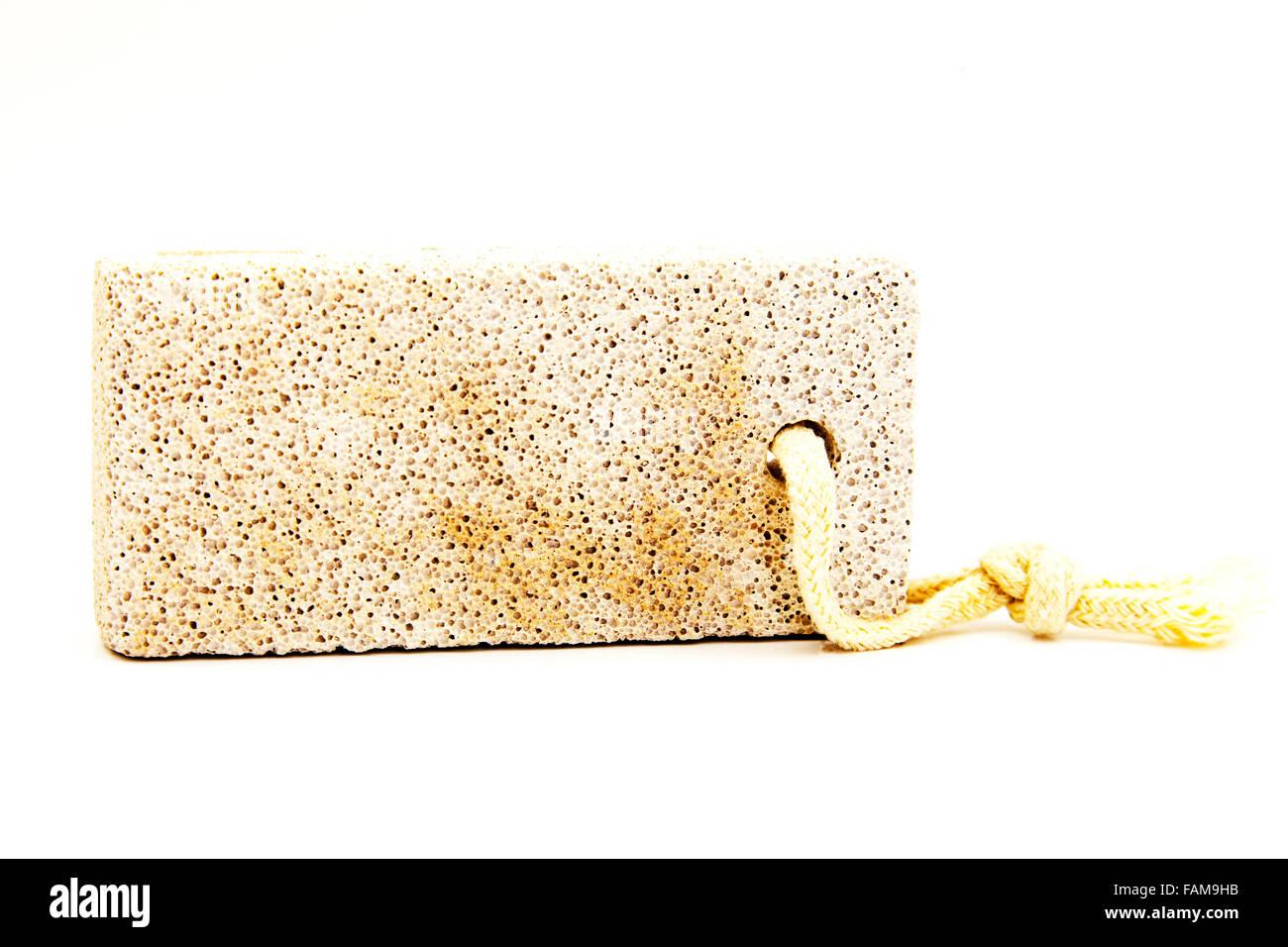 Bimsstein, die poröse Vulkangestein Lava zum Entfernen von trockener Haut Ausschnitt weißen Hintergrund Stockbild