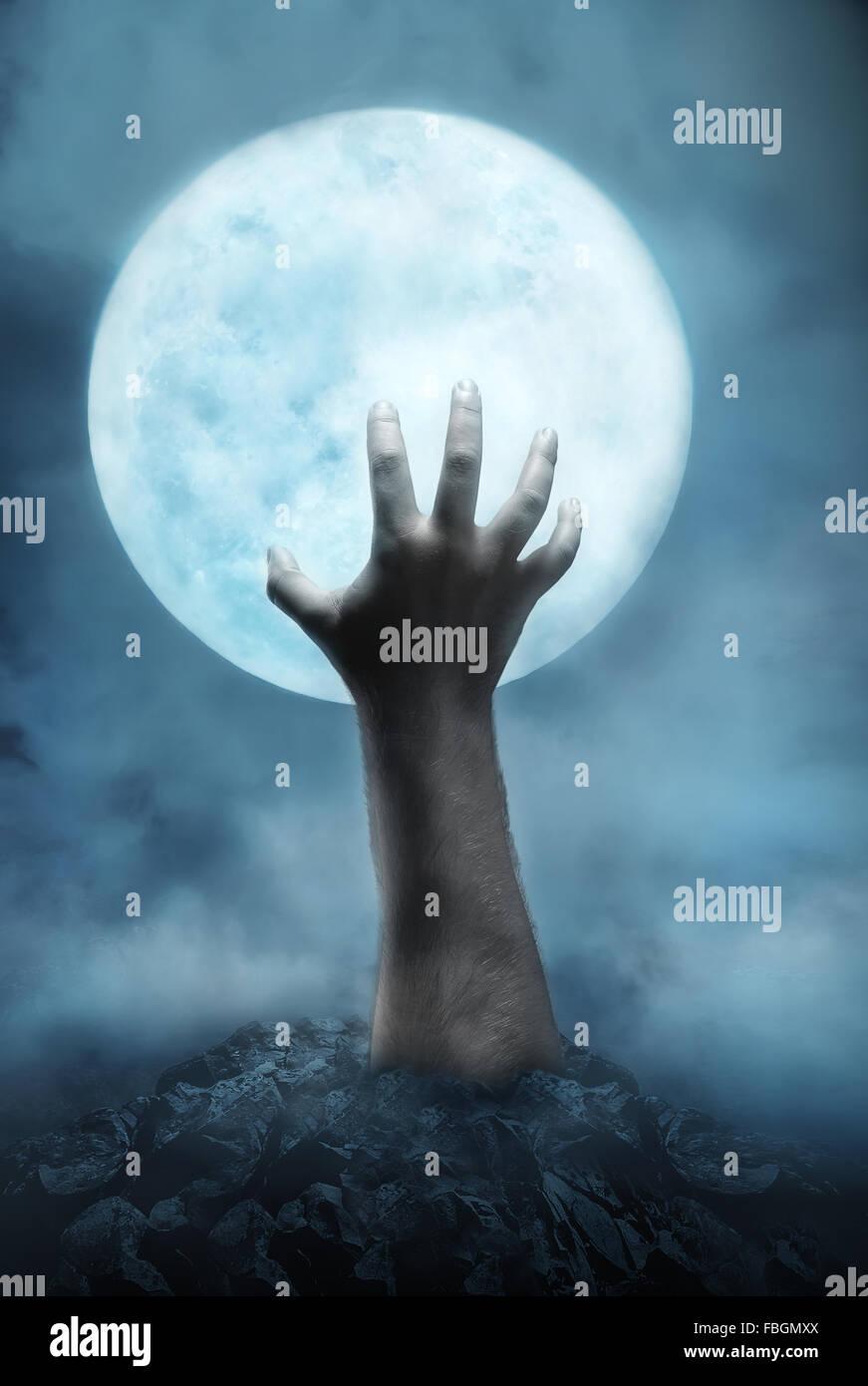 Menschliche Hand aus dem Loch Stockbild