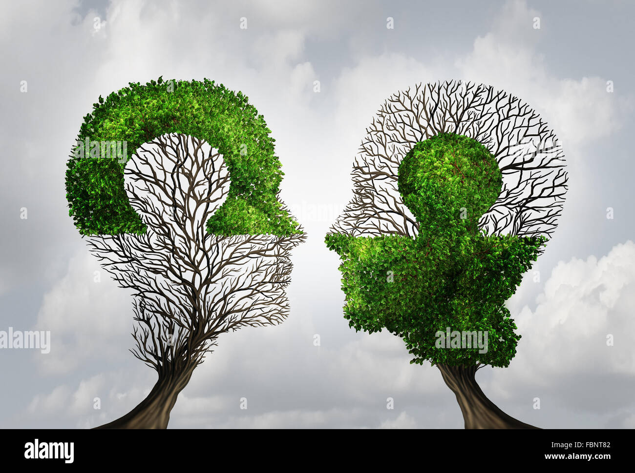 Perfekte Business Partnerschaft als verbindende Puzzle geformt als zwei Bäume in Form von menschlichen Köpfen Stockbild