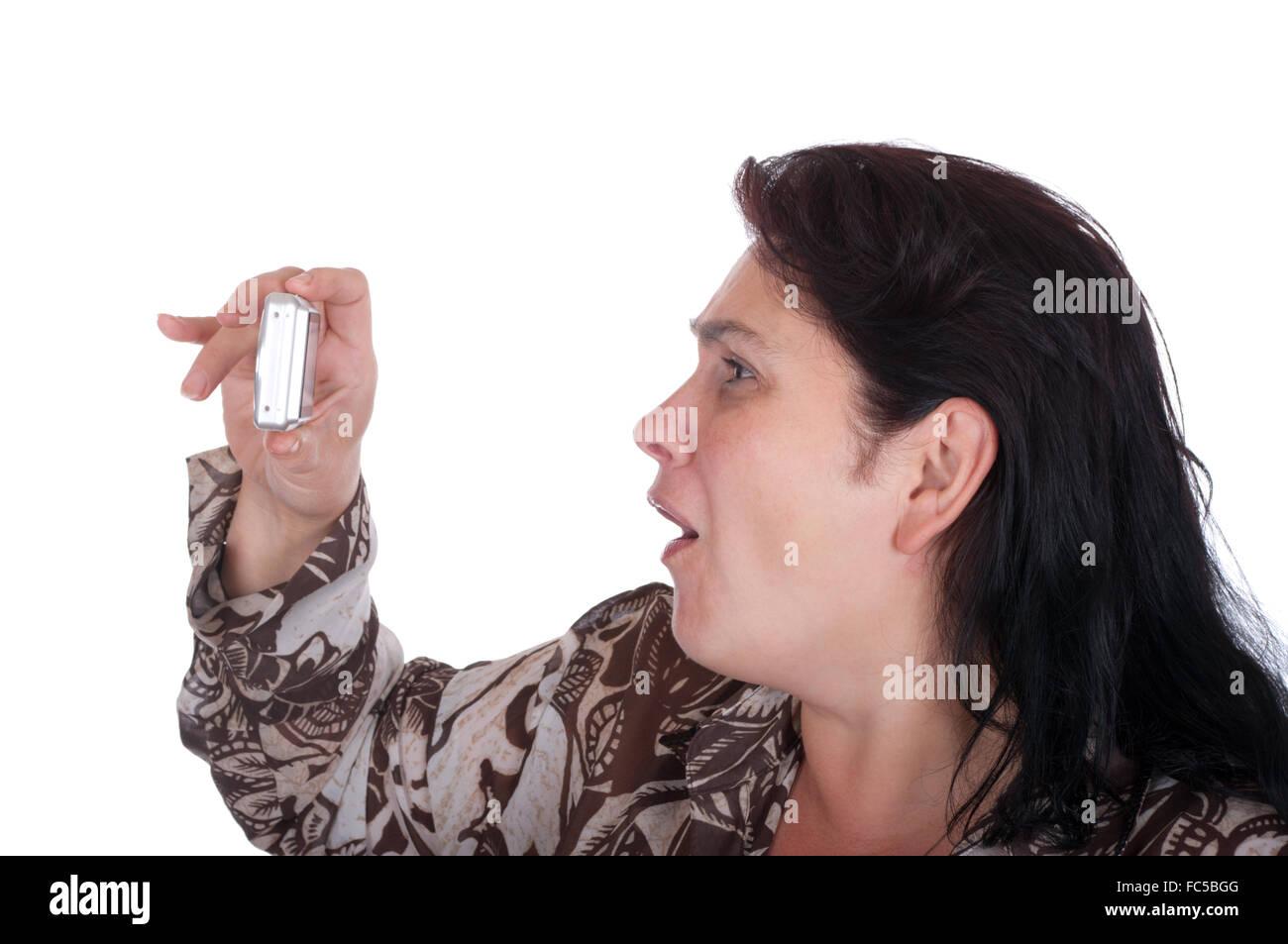 Frau fotografiert emotional die Kamera Stockbild