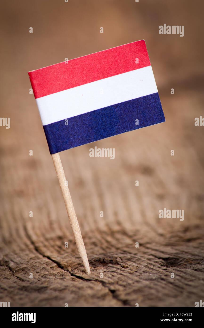 Stilisierte Flagge der Niederlande auf hölzernen Hintergrund Stockbild