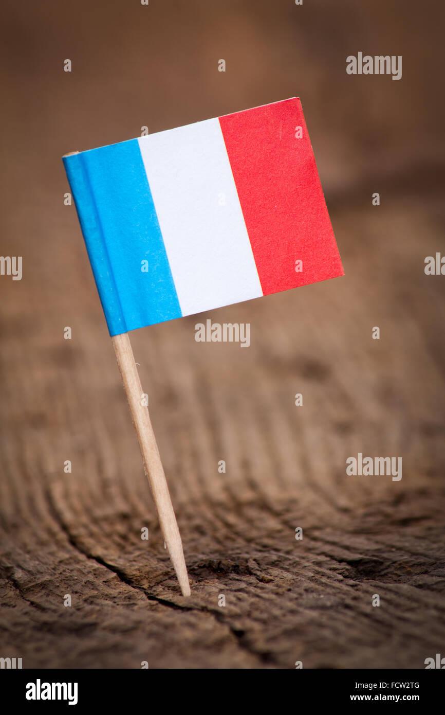 Stilisierte Flagge Frankreichs auf hölzernen Hintergrund Stockbild