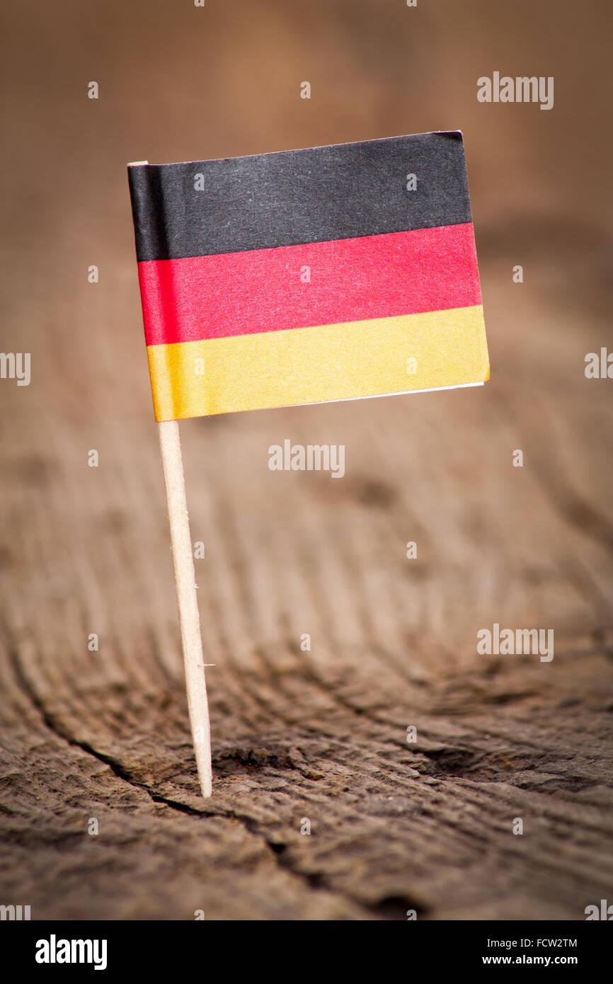 Stilisierte Flagge Deutschlands auf hölzernen Hintergrund Stockbild