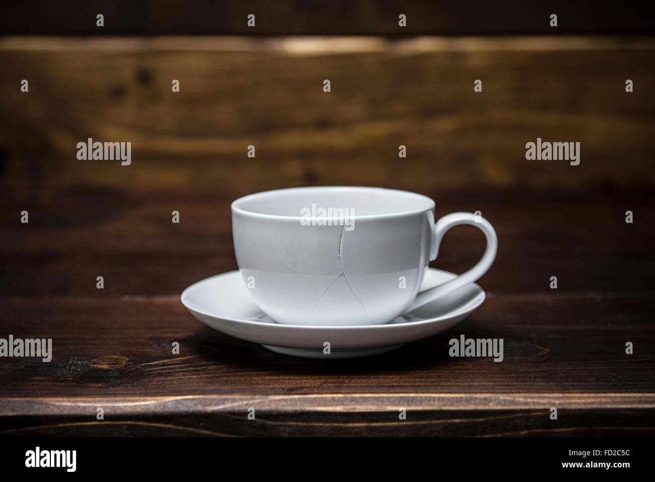 Zerbrochene Kaffeetasse Stockbild