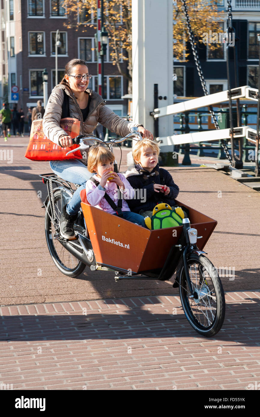 amsterdam bike child stockfotos amsterdam bike child. Black Bedroom Furniture Sets. Home Design Ideas
