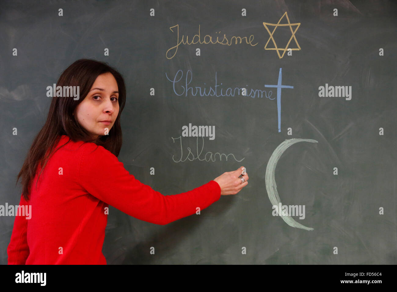 Schullehrer Religionen zu erklären. Stockbild