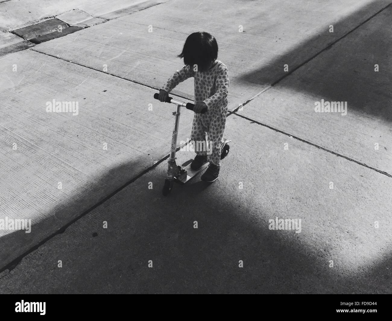 High Angle View Of Boy Push Motorroller Stockbild