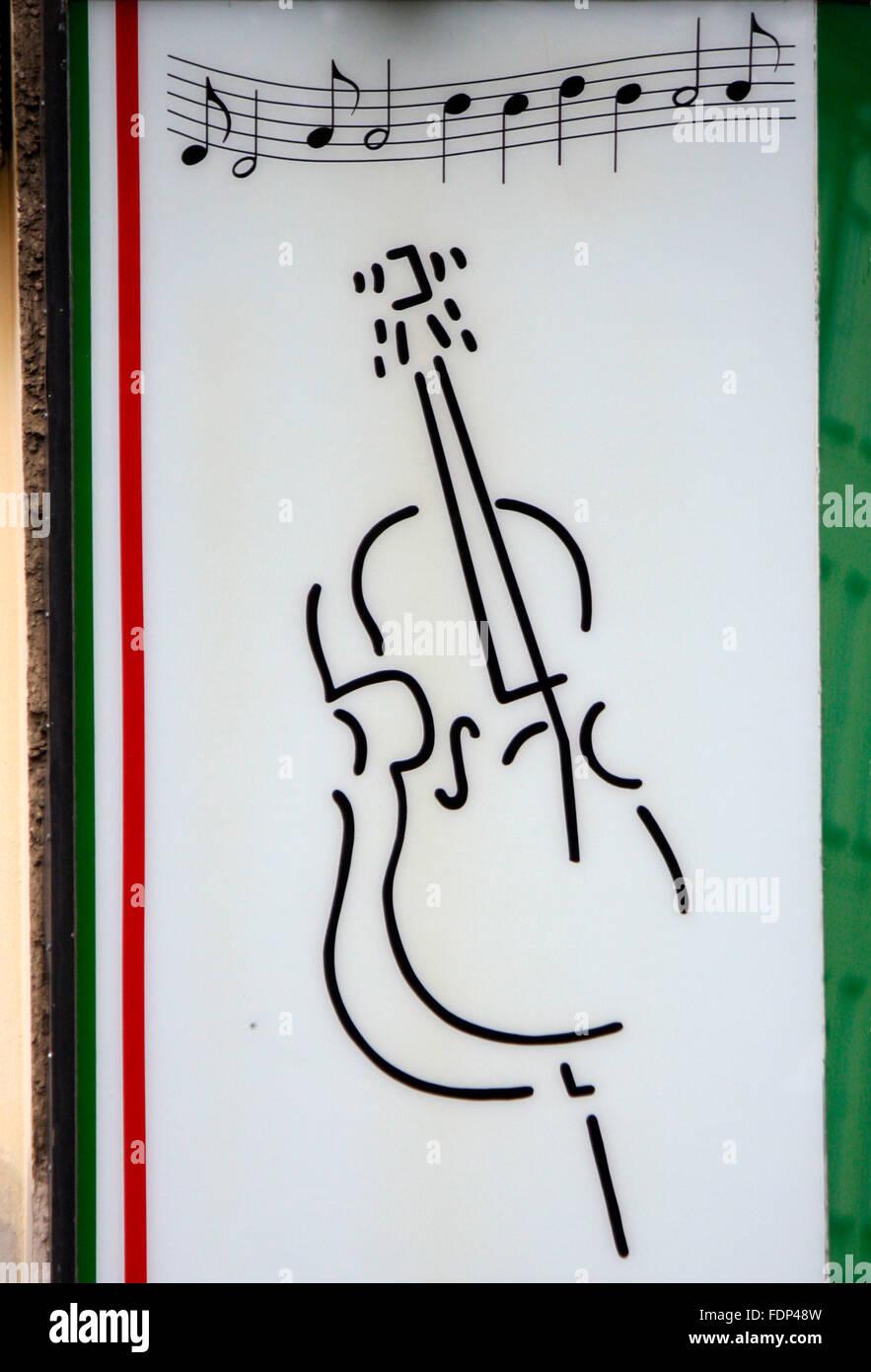 Gitrrensymbol Und Noten ein Italienischem Restaurant Berlin. Stockbild