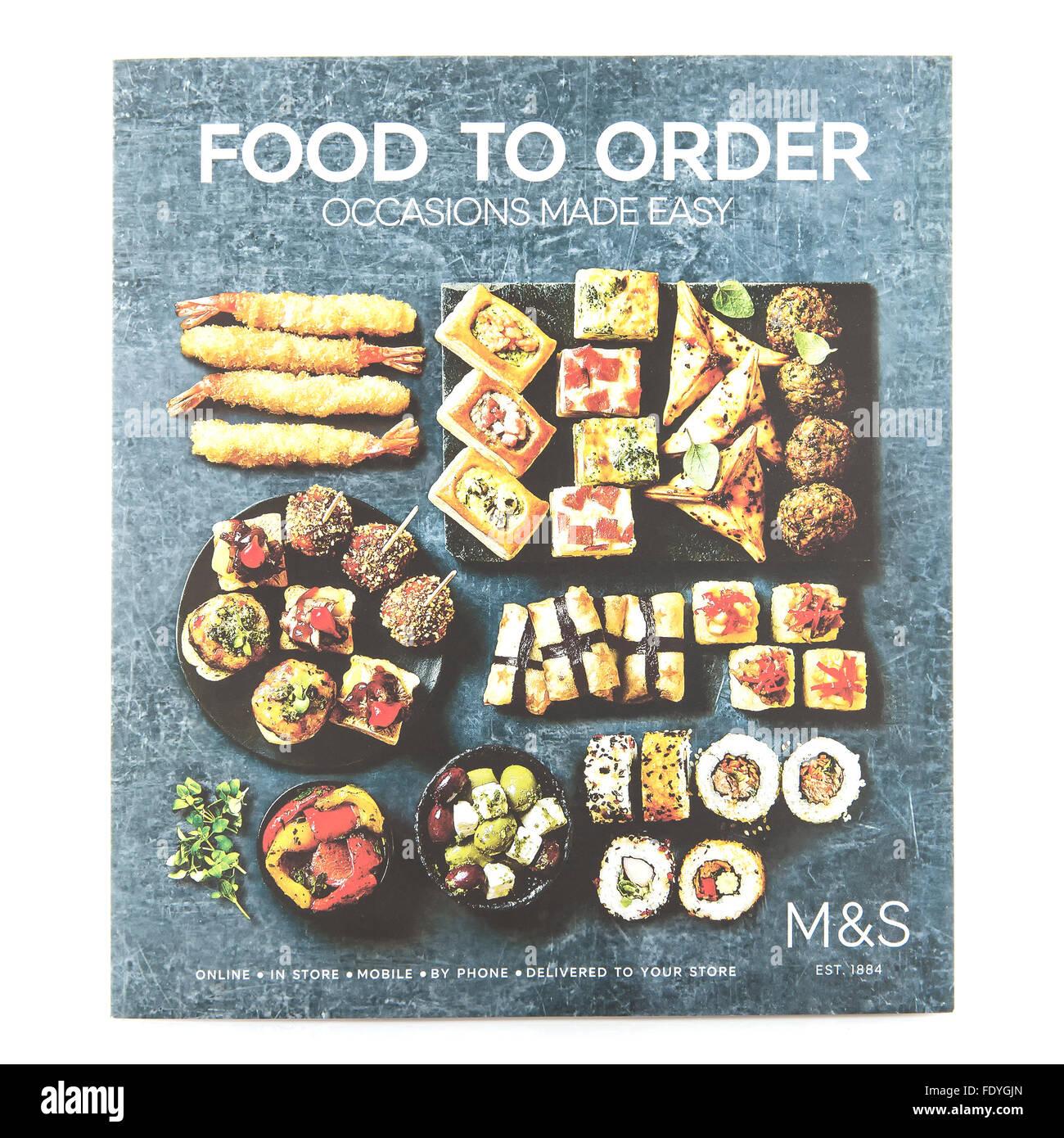 Essen auf Bestellung von Marken & Spencer - Anlässe auf einem weißen Hintergrund leicht gemacht Stockbild