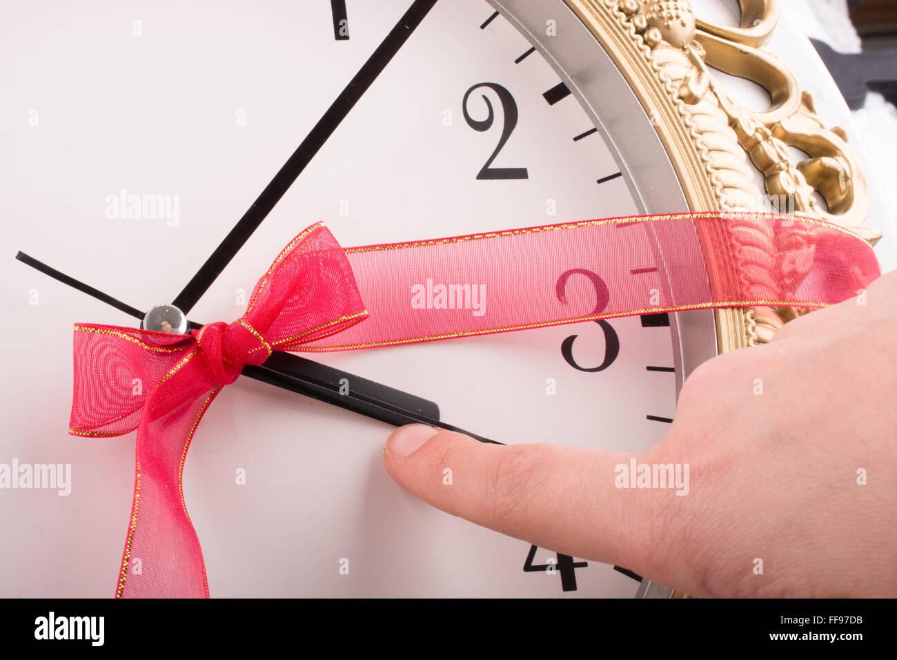 Uhr mit Band in es Stockbild
