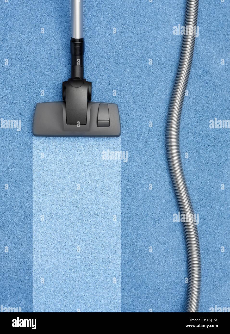 Staubsauger Reinigung des Teppichs Stockbild