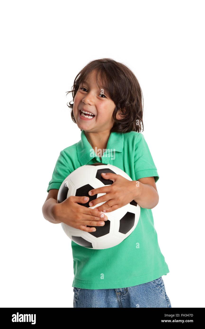 Glücklich kleiner Junge hält einen Fußball auf weißem Hintergrund Stockbild