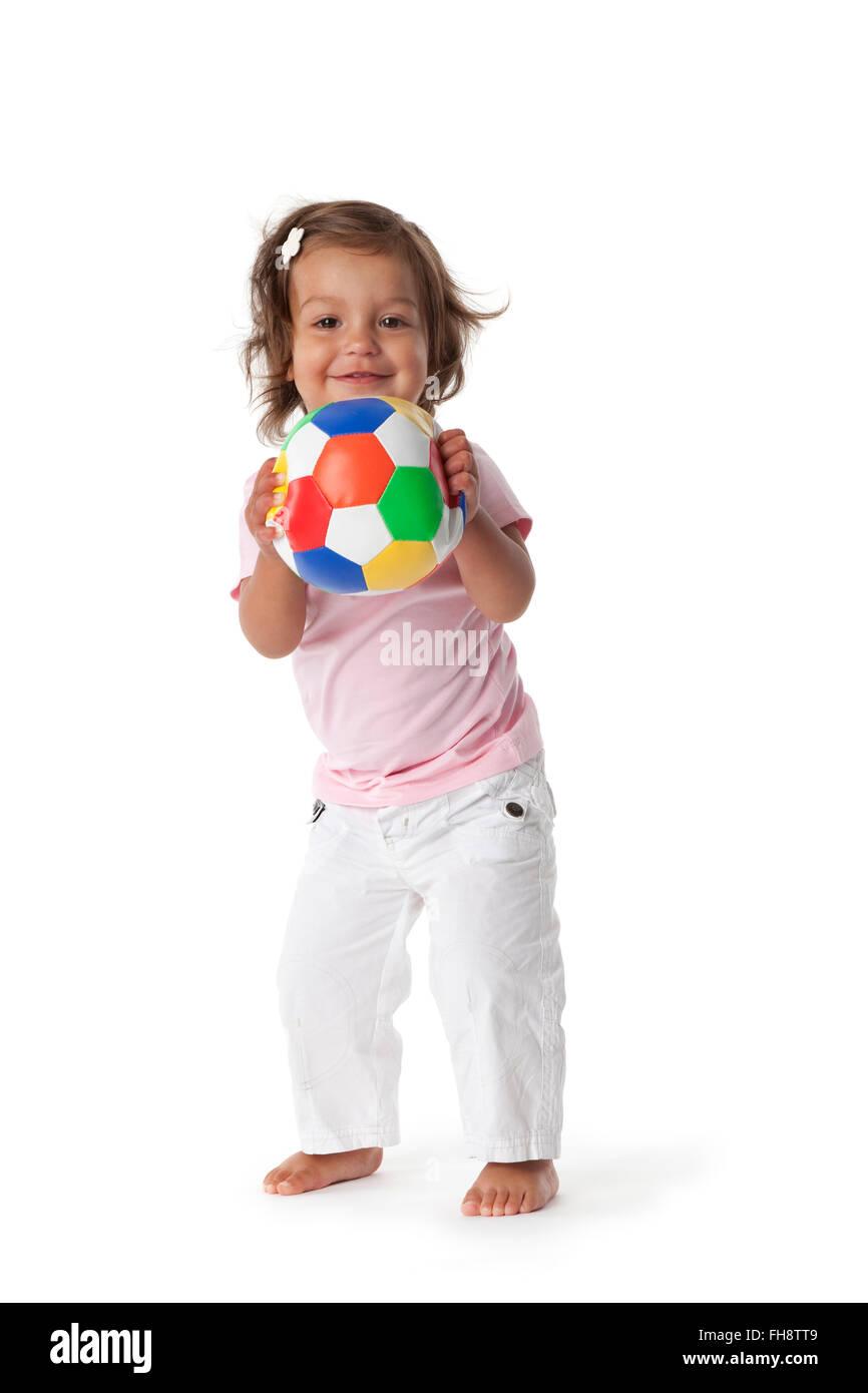 Kleinkind Mädchen spielen mit einem farbigen Punkt auf weißem Hintergrund Stockbild