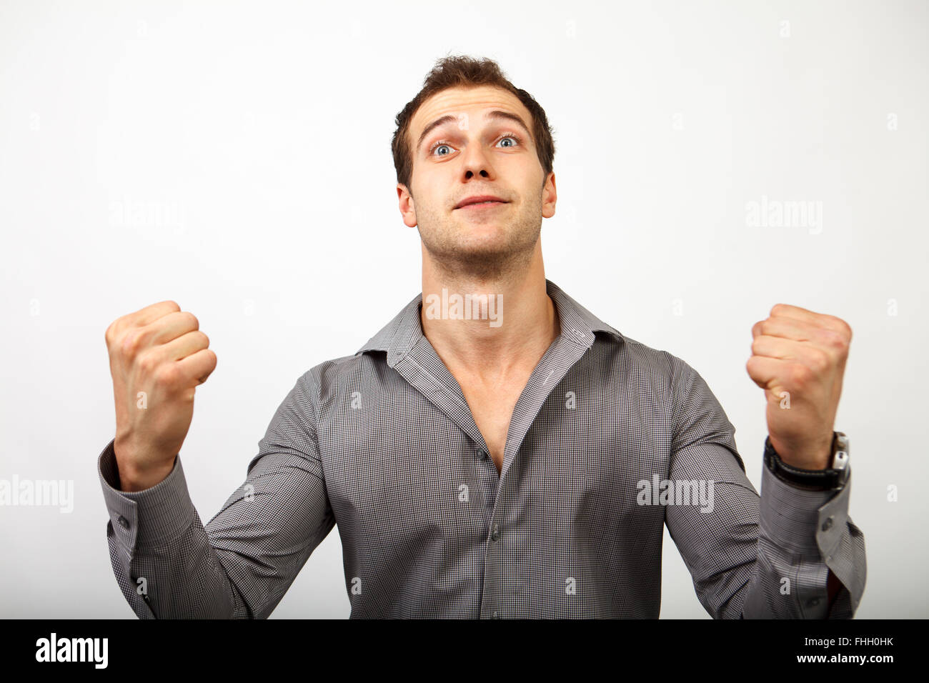 Glücklicher Gewinner Mann isoliert auf weiss Stockbild