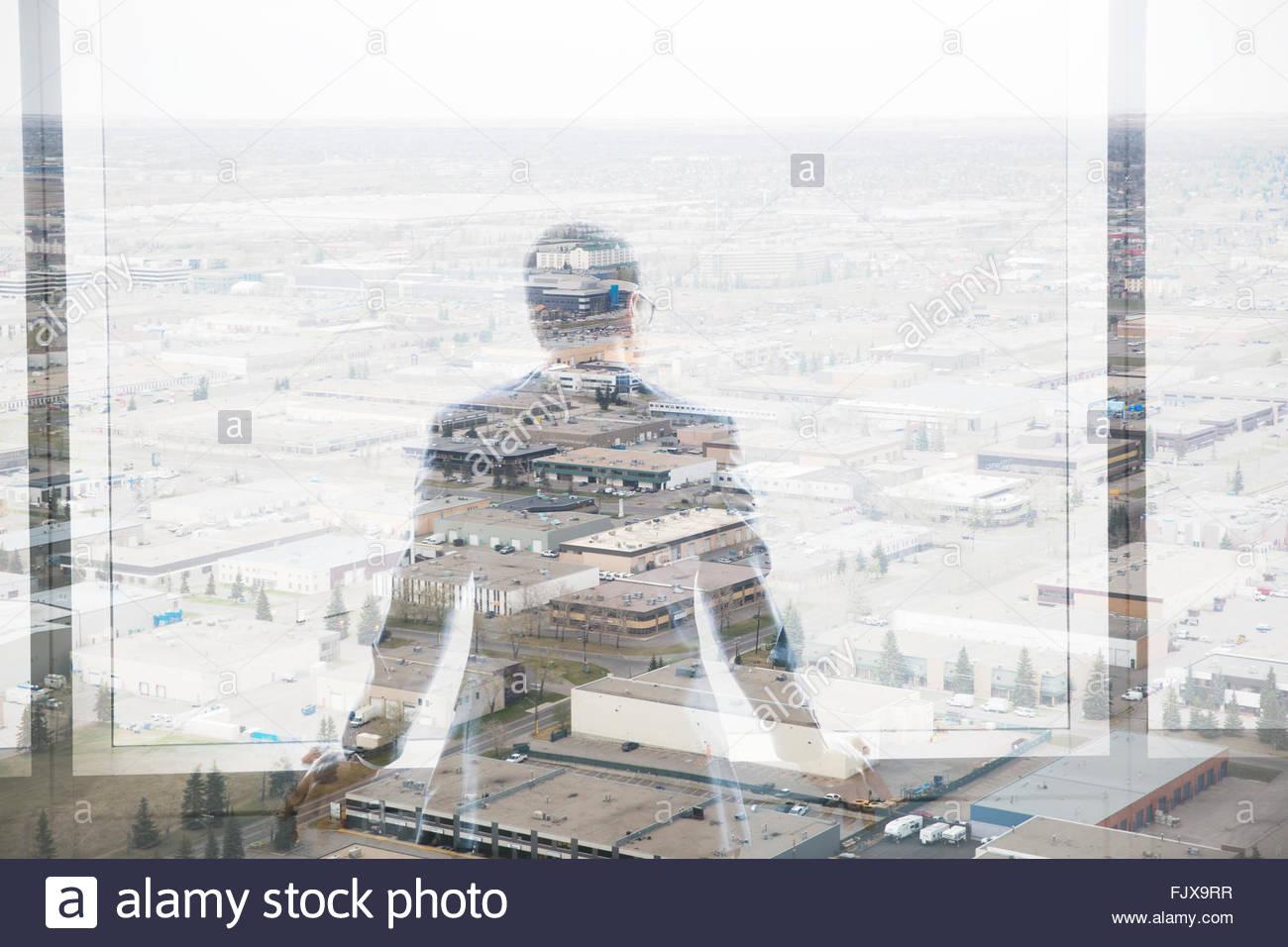Digital composite Geschäftsmann mit Blick auf Industriegebäuden Stockbild