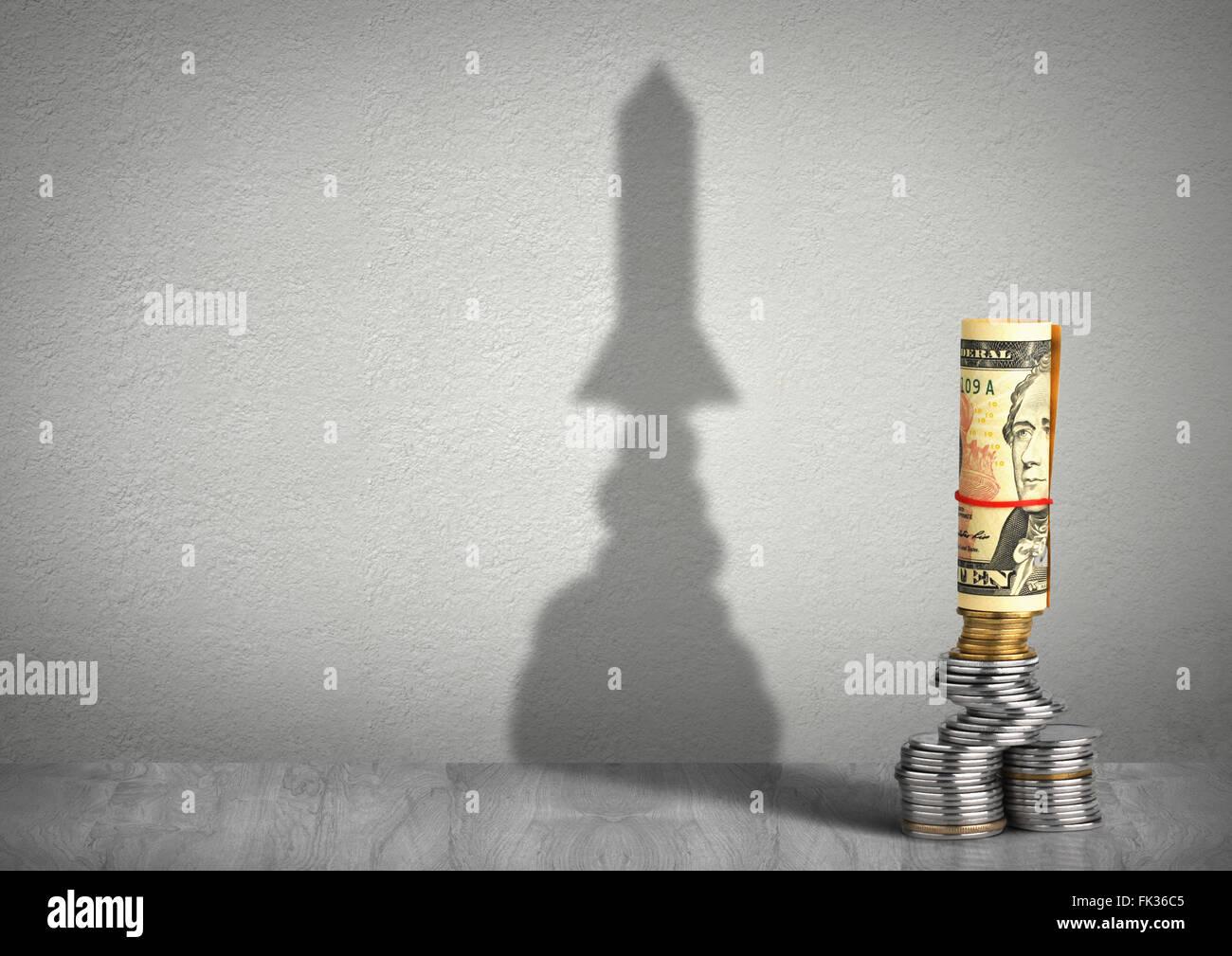 finanzielle Wachstumskonzept, Geld mit Rakete Schatten Stockfoto