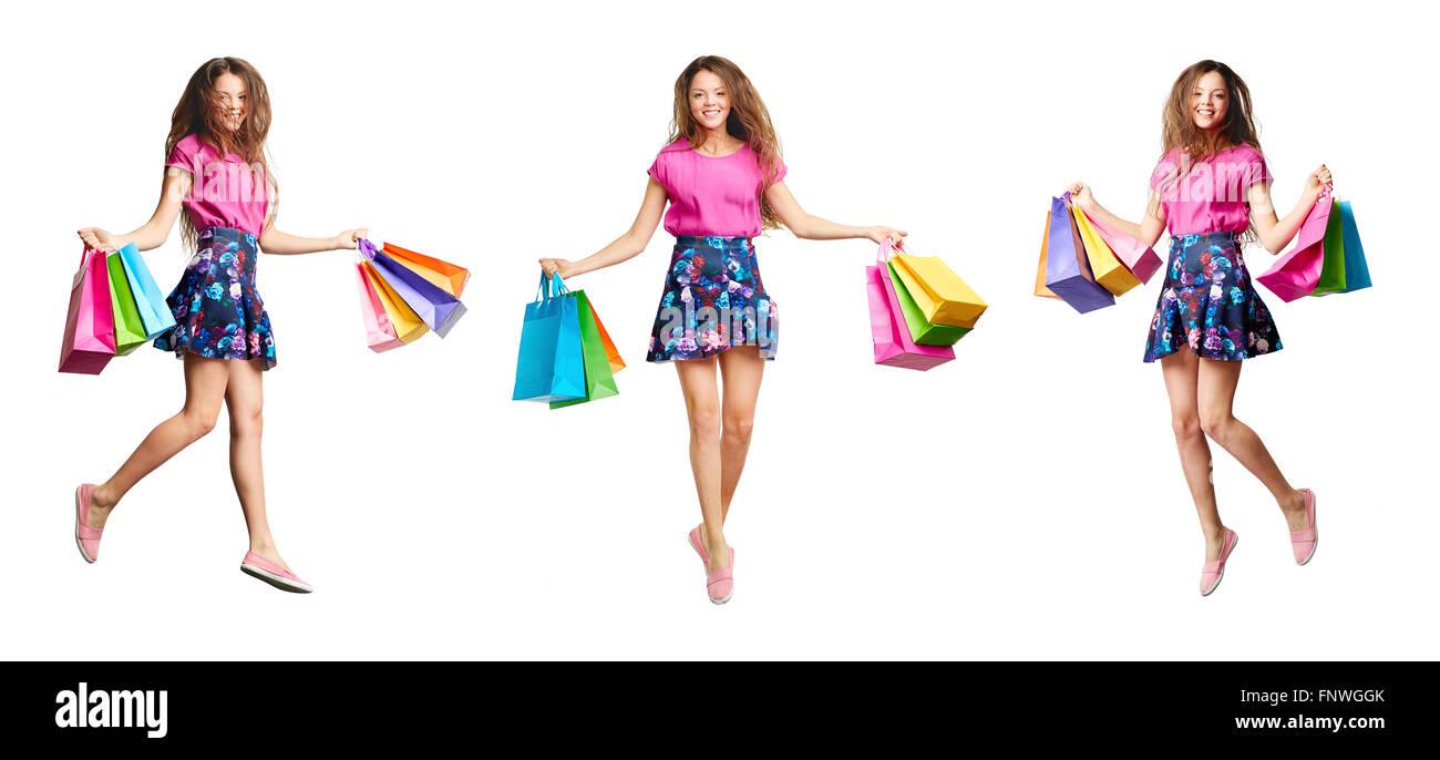 Froh, dass Mädchen mit Paperbags Zufriedenheit zum Ausdruck bringen Stockbild