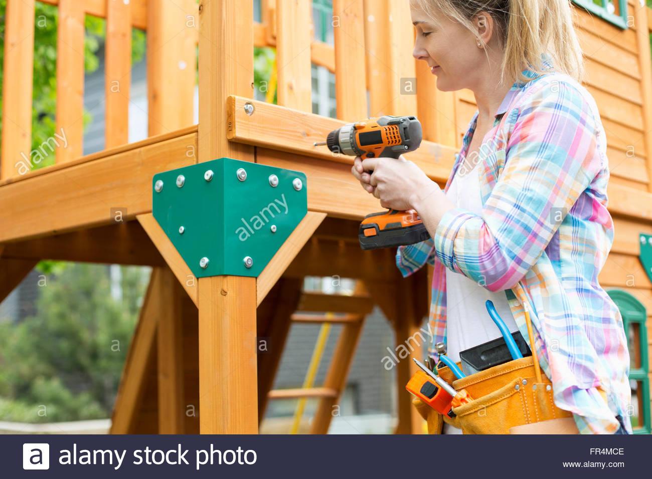 Reife Frau Holz Spiel Gebäudestruktur Stockbild