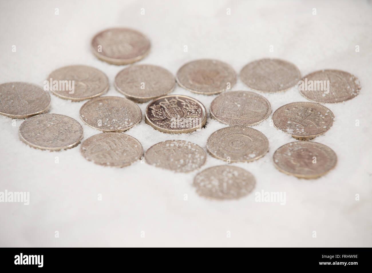 Pfund-Münzen halb begraben in Zucker Stockbild