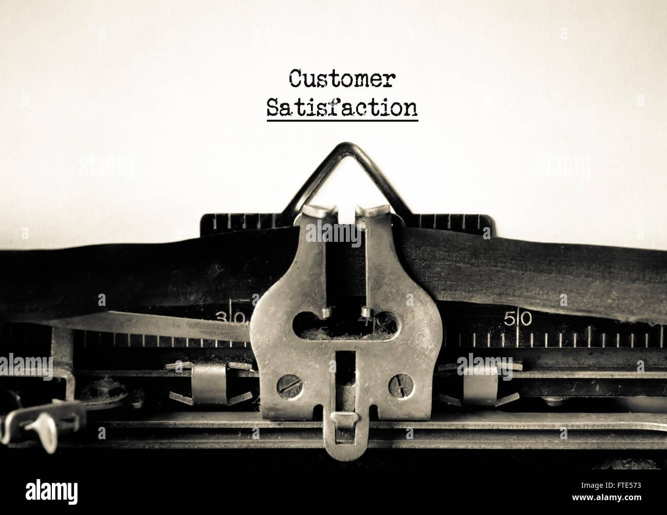 Zufriedenheit der Kunden und Kunden-Service-Motto auf der Vintage Schreibmaschine Stockbild