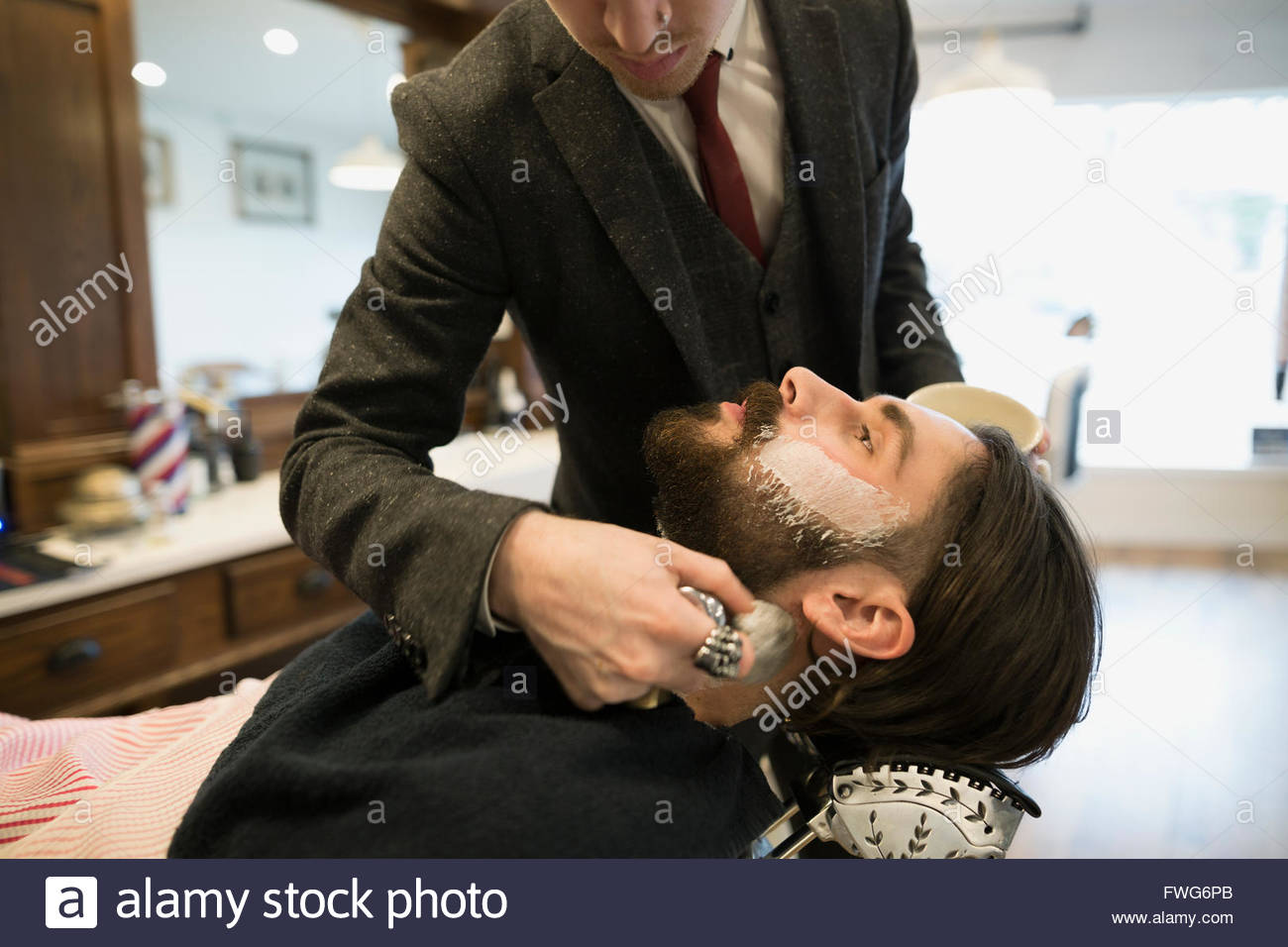 Barbier rasieren Mann Stockbild