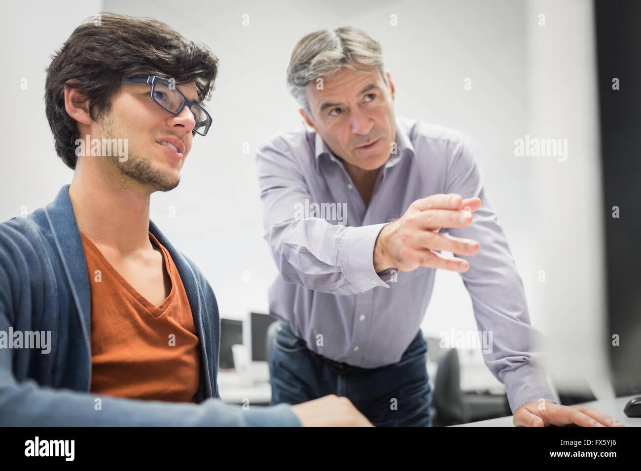 Unterstützung der Student Computerlehrer Stockbild
